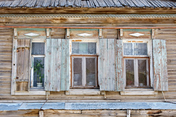 Three old russian style wooden window in Astrakhan, Russia