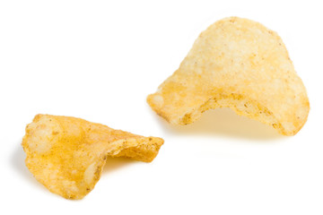 Close-up of two potato chips, isolated on white background