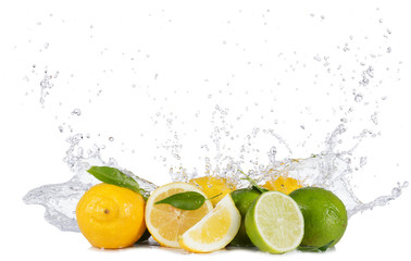 Lemons and limes with water splashes on white