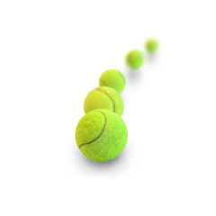 Tennis balls in motion on a white background