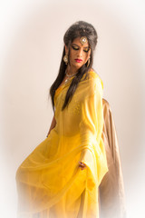 Indian girl model in yellow ceremony dress