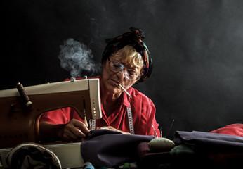 Retro woman sewing and smoking cigarettes