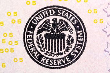 Federal Reserve System sign on five U.S. dollar bill.