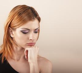 Studio shot of a beautiful pensive young woman.