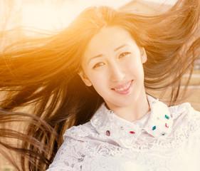 Beauty Romantic Girl Outdoors Closeup. Beautiful Asian Teenage