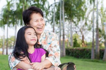 Grandma and grandchild hugging in the park
