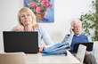 Elderly businesspeople working at home