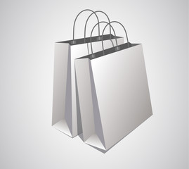Classic empty white shopping bags composition.