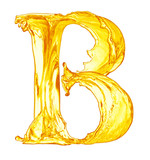 alphabet made of orange juice splash