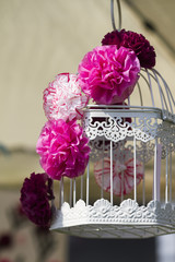 handmade paper flowers on the cage