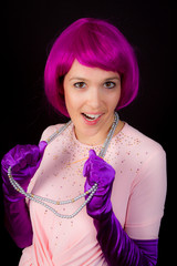 Woman dressed in shiny outfit and purple wig