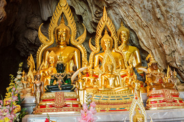 golden buddha statue in the cave
