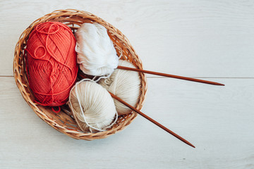 red and white yarn balls in the basket