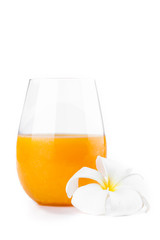 Fresh citrus orange juice with white frangipani flower on white
