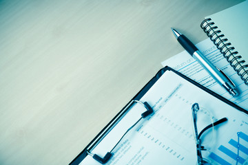 business and financial report with pen on wooden table.Document