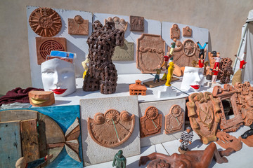 Antiques and sun clocks on the street of Pisa in Italy