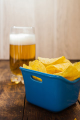 potato chips in a bowl and beer
