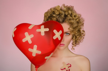 Upset woman with patches on the body and balloon