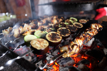 Cooking of kebab on skewers