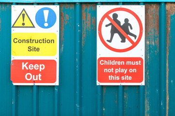 Construction site  warning sign for public to not let children p