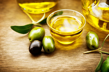 Olives and olive oil. Bowl of extra virgin olive oil