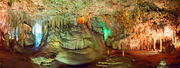 Colorful stalactites and stalagmites in the underground cave