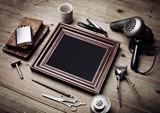 Set of vintage tools of barber shop and old picture frame