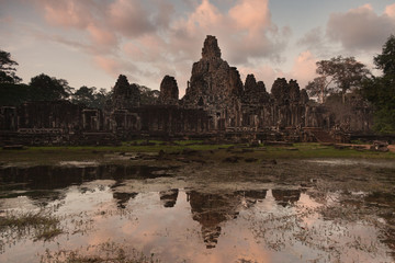 Bayon temple temple at  dusk with reflection