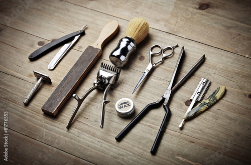 Vintage tools of barber shop on wood desk Poster