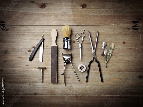 Vintage equipment of barber shop on wood background - 81776711