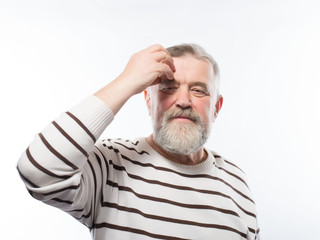 Old man with a beard retired depressed