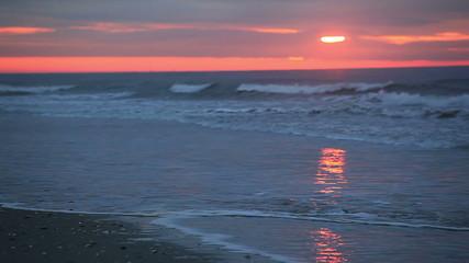 Pink and gray beach sunrise
