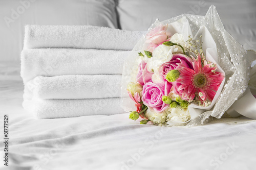 Bouquet on the bed in bedroom