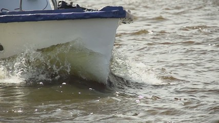 The bow of boat cutting through the water slow motion