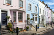 London street of terraced houses without parked cars. - 81778386