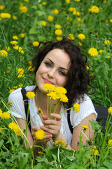 Beautiful young girl with dandelion