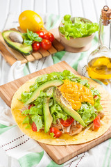 Chicken Tostados. Tortilla with chicken, lettuce and avocado