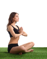 Young woman practicing yoga in the lotus position