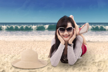 Attractive woman lying on the seaside 1