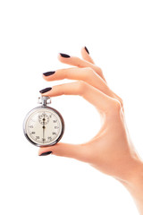 Female hand holding stopwatch set to thirty seconds, black nails