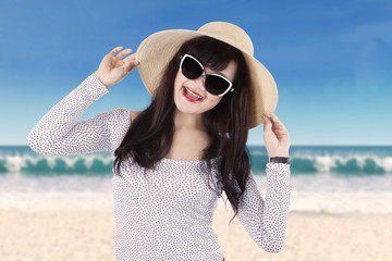 Attractive girl with sunglasses at seaside