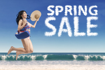Carefree woman with spring sale cloud