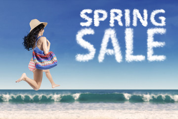 Carefree tourist with spring sale cloud