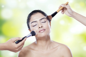 Beauty model apply makeup
