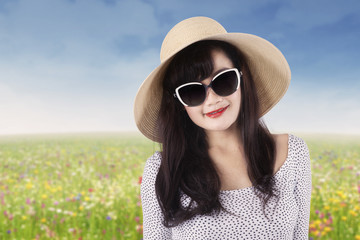 Beautiful woman with sunglasses at field