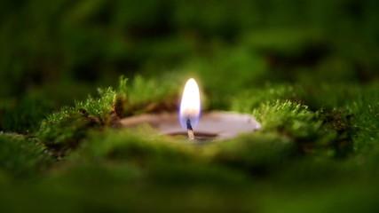 Candles burning at altar