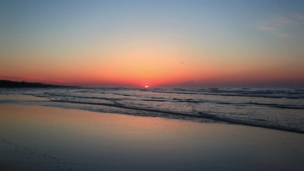 Low angle beach sunrise