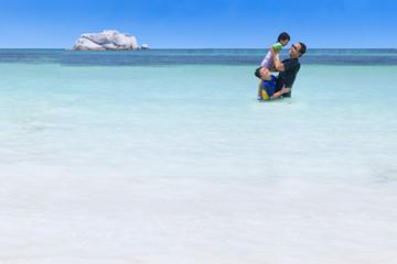 Playful family on the beach