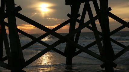 Beach morning under the pier