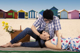 Man fondle his girlfriend at beach poster